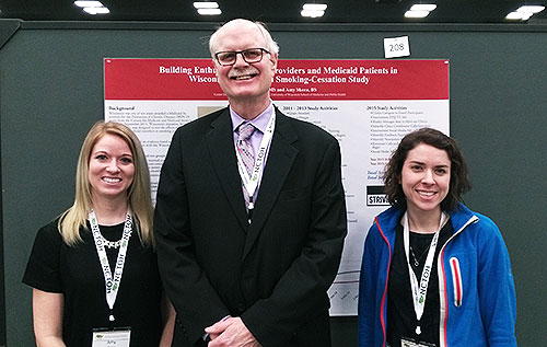 Outreach specialists present their research at a national conference