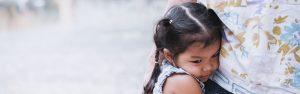 Kid hugs parent