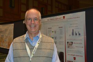 Dr. Bruce Christiansen presents a poster.
