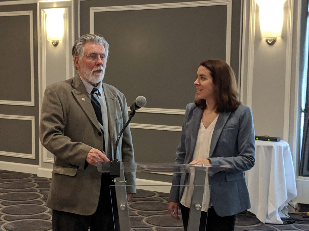 """UW-CTRI Outreach Specialist Allie Gorrilla and Wisconsin Nicotine Treatment Integration Project (WiNTiP) Managing Consultant David """"Mac"""" MacMaster (above) recently spoke about the Bucket Approachandthe importance of addressing nicotine addiction in standard behavioral-health treatment to 220 behavioral health providers in Milwaukee County. The event was held at the Italian Community Center in Milwaukee."""