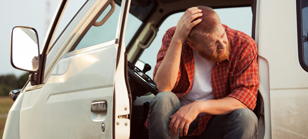 A veteran sits in his pickup truck