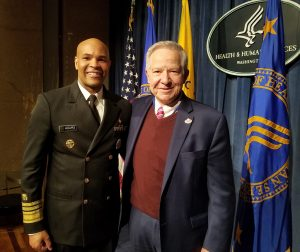 US Surgeon General Dr. Jerome Adams and Dr. Michael Fiore
