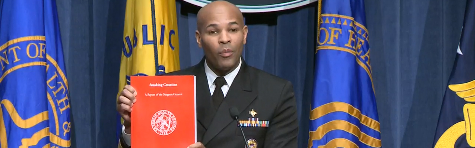 US Surgeon General Dr. Jerome Adams shows his new report