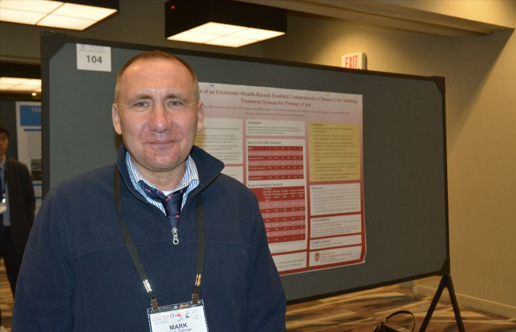 Mark Zehner presented a poster by Dr. Danielle McCarthy, himself, Deejay Zwaga, Rob Adsit, Amy Skora, and Dr. Michael Fiore on how proactive outreach can help more people quit smoking.