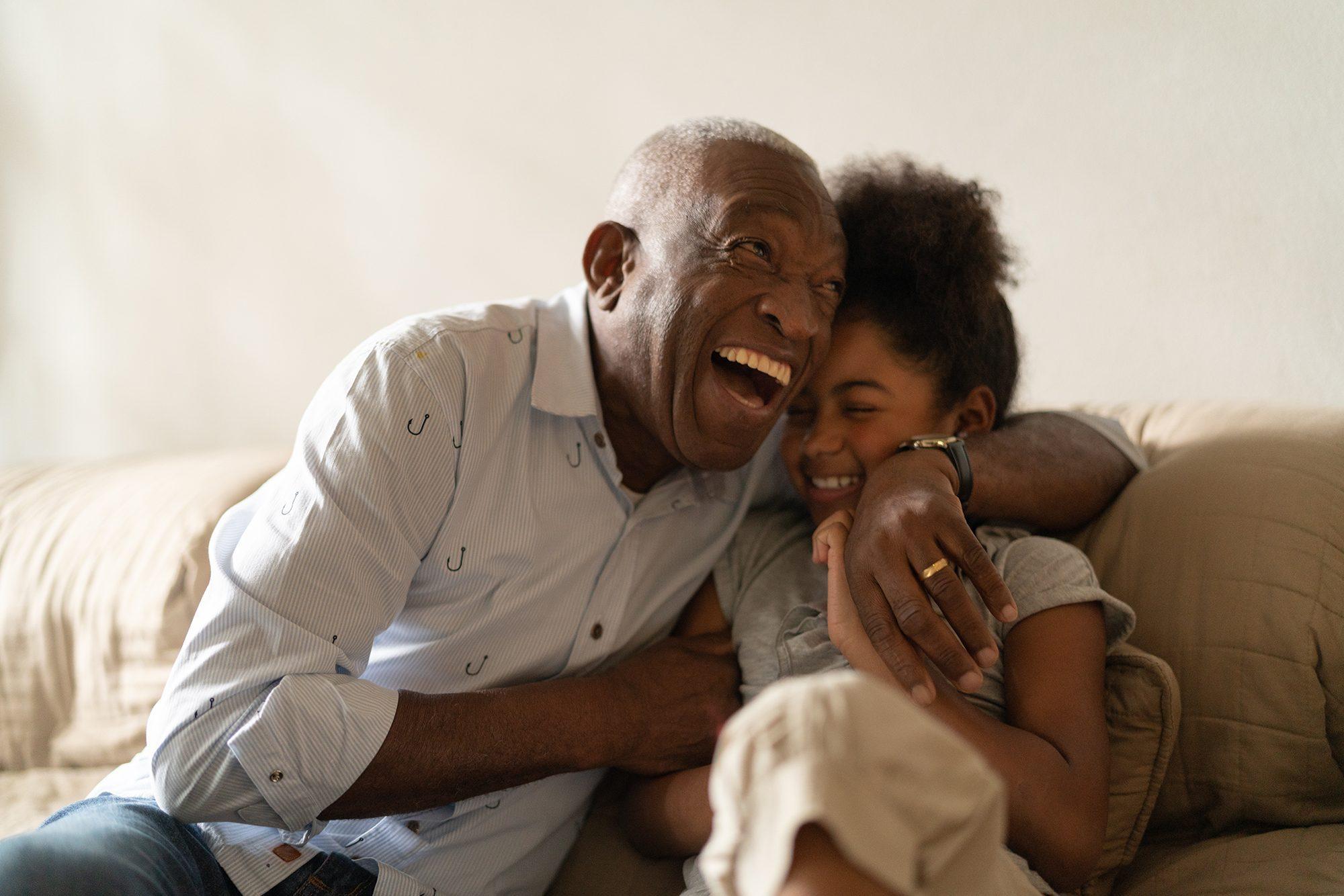 Grandfather hugging granddaughter