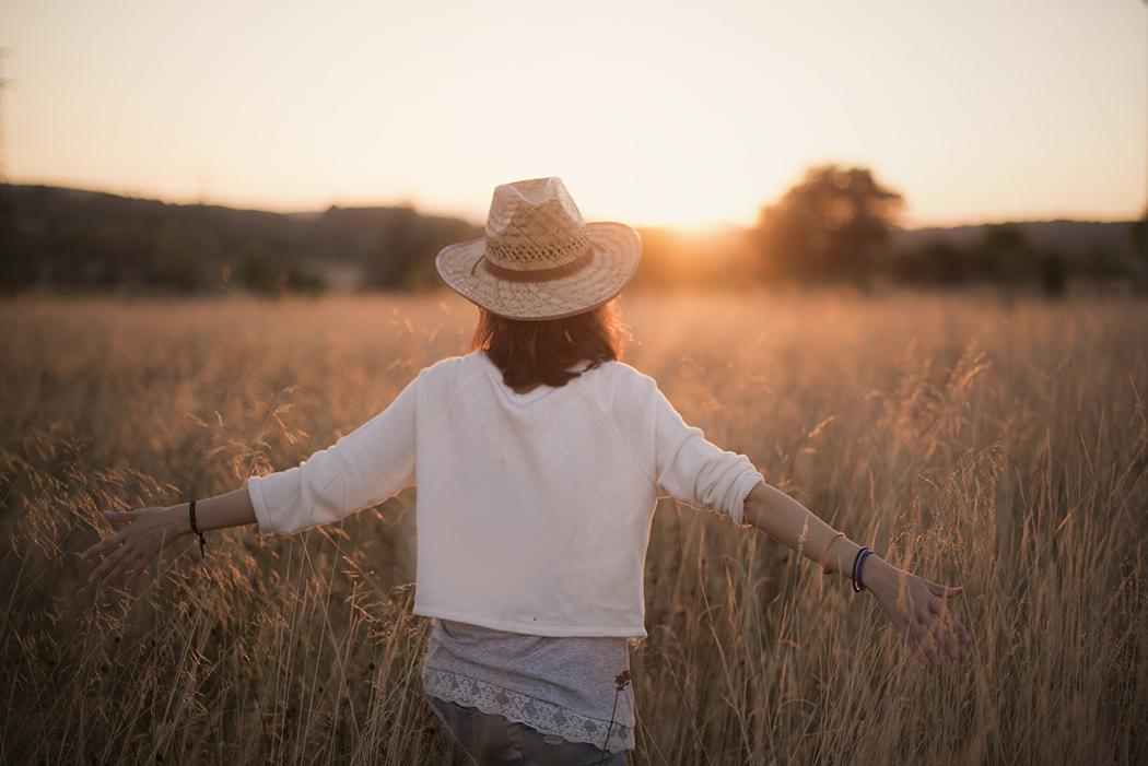 Woman walking through a field, free