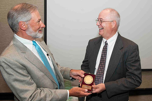 Dr. Bruce Christiansen receives the national Koop Unsung Hero Award
